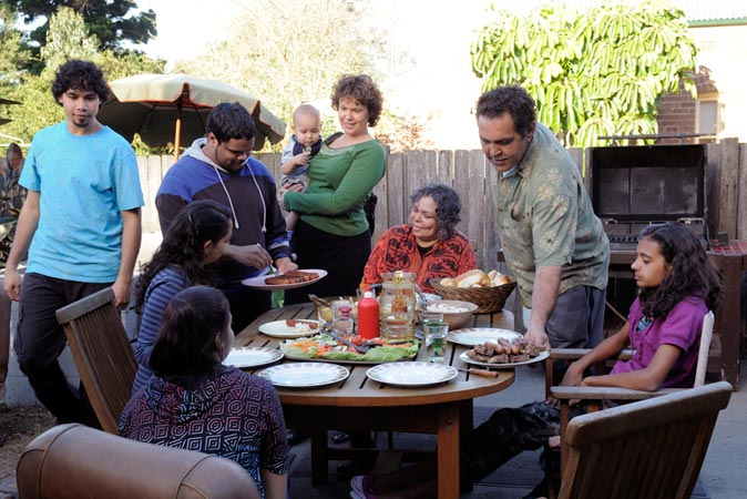 Laura's family enjoying a barbecue | [Episode 1 | 2008 : Laura]