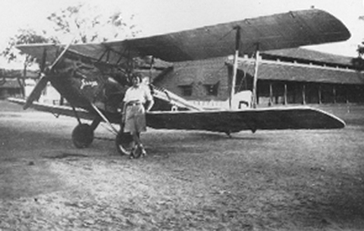 Amy Johnson with her Gipsy Moth biplane at a stopover in India on her solo flight to Australia, 1930